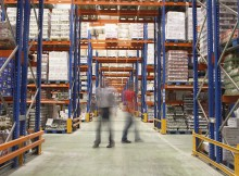 Blurred men walking in the warehouse
